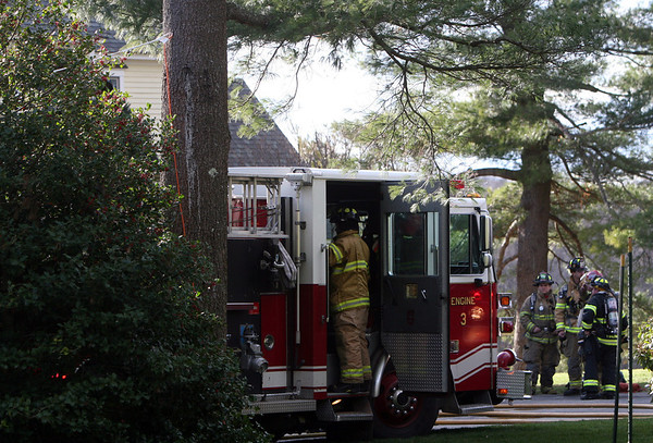 ALLEGRA BOVERMAN/Staff photo. Gloucester Daily Times. Essex: Firefighters from several area departments were assisting at the scene of a fire at 72 Belcher Street in Essex on Friday afternoon.
