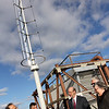 ALLEGRA BOVERMAN/Staff photo. Gloucester Daily Times. Gloucester: The new turbine on top of O'Maley Middle School. School officials and members of the Gloucester Education Foundation were on hand. From left are Ed Shoucair, assistant superintendent Brian Tarr, superintendent Richar Safier and John and Mollies Byrnes.