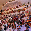 ALLEGRA BOVERMAN/Staff photo. Gloucester Daily Times. Gloucester: Details of the huge village holiday display at Vincent Orlando's home in Gloucester. There are over 200 pieces in this display, which fills the family's living room. There are some pieces that don't fit in the display at all, so they remain packed away.
