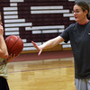 ALLEGRA BOVERMAN/Staff photo. Gloucester Daily Times. Gloucester: New Gloucester Girls Varsity Basketball team head coach Lori Sanborn, right, works with Heather Cain, left.