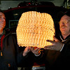 ALLEGRA BOVERMAN/Staff photo. Gloucester Daily Times. Rockport: Rockport firefighters Kevin Beaulieu (right) and Bill Montgomery,  of the Rockport Fire Department, hold up the New Year's Eve ball that will be lowered from the ladder truck at Dock Square in the final countdown to 2012. They built the ball about seven years ago.