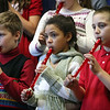 ALLEGRA BOVERMAN/Staff photo. Gloucester Daily Times. Gloucester: Playing on their recorders during the East Gloucester Elementary School Winter Concert on Tuesday are third graders, from left: Henry Richard, Alexis Nivar and Tucker Destino. The whole student body performed for family and friends.