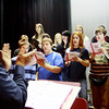 Jim Davison, music director at Rockport Public High School, gets students warmed up to rehearse on Thursday morning in preparation for the Holiday Winter Concert that night. Jesse Poole/Gloucester Daily Times Dec. 15, 2011