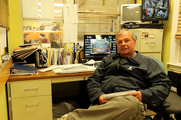Jim Noble, Action's shelter manager, sits in the office of the Action's Rogers Street location. Jesse Poole/Gloucester Daily Times Dec. 05, 2011