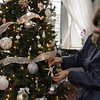 ALLEGRA BOVERMAN/Staff photo. Gloucester Daily Times. Rockport: The McNamara home will be on view during the Seashells and Jingle Bells Inn and Home Kitchen Tour of Rockport which will be held on December 10th from 1- 6 p.m. Diane Ambrose admires the shell-themed tree.