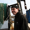 ALLEGRA BOVERMAN/Staff photo. Gloucester Daily Times. Gloucester: Charlie Williams, 25, of Gloucester, aboard the trawler Lady Jane at the Gloucester Marine Railways. He will soon be out catching shrimp.
