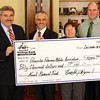 ALLEGRA BOVERMAN/Staff photo. Gloucester Daily Times. Gloucester: The <br /> Gloucester FIshermen's Athletic Association received a donation from Cape Ann Savings Bank on Thursday. From left are: Dick Wilson, David Amero, Roger Corbin (Big Gift fundraisers for the Newell Renewal Fund), Cape Ann Bank President Bucky Rogers, Vice President Bob Gillis, Assistant Treasurer Jane Pallazola, GFAA Treasurer Tim Philpot, GFAA President Jonathan Pope and GFAA member and fundraiser Jay Somers.