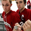 ALLEGRA BOVERMAN/Staff photo. Gloucester Daily Times. Gloucester: Kathy Milbury of Rockport brought her brother Michael MIlbury's Stanley Cup ring to the Gloucester high school varsity boys hockey team practice on Tuesday. Wearing the ring at right is co-captain Johnny Interrante, with co-captain Vincenzo Terranova.