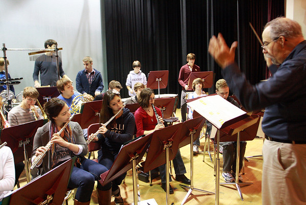 Jim Davison, music director at Rockport Public High School, directs students as they get warmed up and rehearse on Thursday morning in preparation for the Holiday Winter Concert that night. Jesse Poole/Gloucester Daily Times Dec. 15, 2011