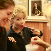 Essex-Jake Zschau, 4, of Manchester, visits the T.O.H.P. Burnham Library on Tuesday afternoon with his sister Lily, 7, and their sitter Lydia French, all to celebrate National Hot Cocoa Day with hot cocoa itself and candy canes too. Jesse Poole/Gloucester Daily Times Dec. 13, 2011