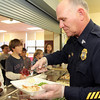 Courtesy photo/Gloucester Daily Times. Rockport: Members of the Rockport Police Department served lunch to Rockport Elementary School students on Friday. The school and police department have been planning to do this for a while and hope to make it a new tradition. Sgt. Bob Tibert, right, serves fourth grader Luke Syrigos-McGinn, at far left.