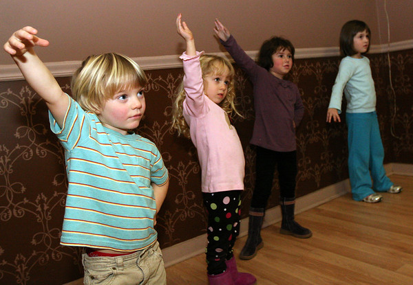"ALLEGRA BOVERMAN/Staff photographer. Gloucester Daily Times. Gloucester: Performing ""I'm a Little Teapot"" during ""My First Acting Class,"" with teacher Jape Payette, not shown, are, from far left: Julian Nixon, 4, of Lanesville, Lizzie Sly, 4, of Rockport, Emrose Williams, 4, of Rockport, and Alexandra Johnson, 6, of Rockport. The drop-in class is from 4:30 - 5:30 p.m. every Tuesday at the Pleasant Street Tea Co. on Pleasant Street in Gloucester for children aged 4-6 years old. Every six to eight weeks, they put on a little show for parents, and the kids learn the basics of acting, learn to listen, help each other out, stay still and not fidget and other important skills for not only acting, but life in general. Contact Payette at 978-879-9293 for more information or see japescape.com"