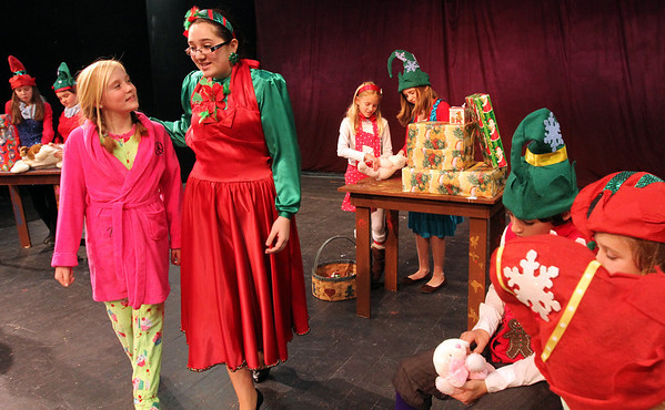 "ALLEGRA BOVERMAN/Staff photo. Gloucester Daily Times. Gloucester: During rehearsal of ""Holiday Delights,"" a holiday celebration of stories, songs and dance by the Gloucester Stage Youth Acting Workshops. From left are Lily Armstrong, as Lily, and Jessica Ingaharro as Mrs. Claus, walking in the elves workshop."