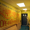 Scrawled across one of the shelter's walls are a few encouraging words and phrases chosen by some who stay or have stayed in the shelter. Jesse Poole/Gloucester Daily Times Dec. 05, 2011