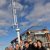ALLEGRA BOVERMAN/Staff photo. Gloucester Daily Times. Gloucester: The new turbine on top of O'Maley Middle School. School officials and members of the Gloucester Education Foundation were on hand. From left, in front, are Maggie Rosa, Ed Shoucair, assistant superintendent Brian Tarr and science teacher Amy Donnelly. Back row, from left, are Joe Rosa, Superintendent Richard Safier,  and John and Mollie Byrnes.
