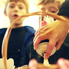 Essex-Conner McGrath, right, watches as children's librarian April Wanner, adds whipped cream to his hot chocolate. Conner's brother Logan waits for his own cup at the T.O.H.P. Burnham Library on Tuesday afternoon, where an event was held to celebrate National Hot Cocoa Day. Jesse Poole/Gloucester Daily Times Dec. 13, 2011