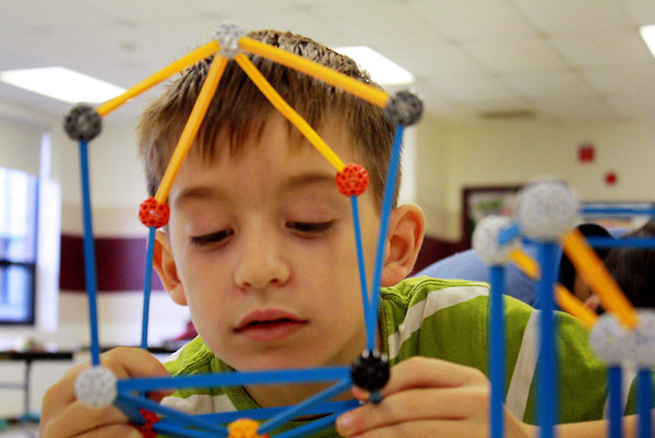 Jack Cahaill, 7, carefully accesses the structure that he is assembling at a parent-run math program hosted at Rockport Elementary School on Saturday morning. Jesse Poole/Gloucester Daily Times Dec. 15, 2011
