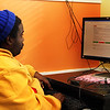 Leroy Keeles, who occasionally stays at the shelter, sits at a computer in Action's lobby on Monday afternoon. Jesse Poole/Gloucester Daily Times Dec. 05, 2011