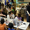ALLEGRA BOVERMAN/Staff photo. Gloucester Daily Times. Gloucester: Organizers said there were about 66 children in the first hour  on Friday afternoon at Art Haven working on decorated buoys to be hung on the Lobster Trap tree on Satuday before it will be lit.