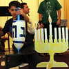 ALLEGRA BOVERMAN/Staff photo. Gloucester Daily Times. Gloucester: Dozens of menorahs were lit for the first night of Hanukkah during the community Hanukkah party held at Temple Ahavat Achim in Gloucester on Tuesday evening. Nadav Gerber, 10, was Hershel in a performance by hebrew school students of Hershel and the Hanukkah Goblins.