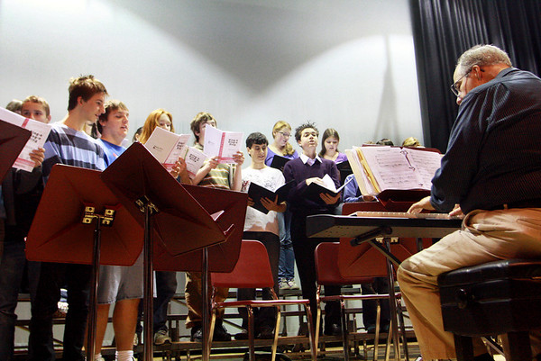 Jim Davison, music director at Rockport Public High School, plays the piano as students warm up their voices and rehearse on Thursday morning in preparation for the Holiday Winter Concert that night. Jesse Poole/Gloucester Daily Times Dec. 15, 2011