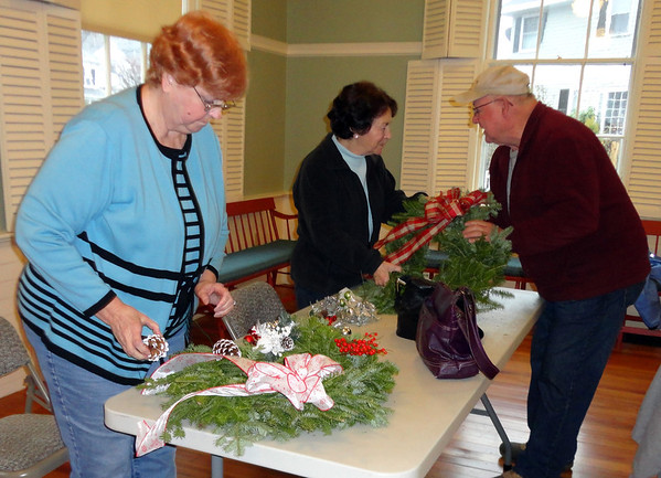 Photo courtesy of Diane Bertolino/Gloucester Daily Times. Rockport: About 15 people participated in a wreathmaking workshop held at the Community House on Wednesday afternoon. Working on their wreaths are, from left: Peggy Fay, and Karen Jylkka and John Wonson was giving them helpful tips.