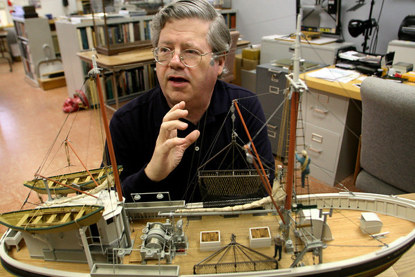ALLEGRA BOVERMAN/Staff photo. Gloucester Daily Times. Gloucester: Erik Ronnberg, Jr. with the model scallop dragger, Bright Star, that he built.