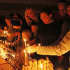 ALLEGRA BOVERMAN/Staff photo. Gloucester Daily Times. Gloucester: Dozens of menorahs were lit for the first night of Hanukkah during the community Hanukkah party held at Temple Ahavat Achim in Gloucester on Tuesday evening.