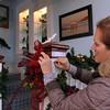 ALLEGRA BOVERMAN/Staff photo. Gloucester Daily Times. Rockport: Sue Andersen adds decorations to the stairwell of the Captain's House Inn on Tuesday morning in preparation for the Seashells and Jingle Bells Inn and Home Kitchen Tour of Rockport which will be held on December 10th from 1- 6:00pm - Visit 4 beautiful seaside homes and 6 inns decked out for the holidays. There will be demonstrations and fun events at each location including seasonal food sampling, candy making, gingerbread house construction, music and a visit to Santa's cottage The tour and registration will begin at Rockport Inn and Suites at 183 Main St. in Rockport. Tickets are $15 in advance and $20 on event date. Advance tickets may be purchased at Ace Hardware Stores in Gloucester and Rockport, Brothers Brew in Rockport, Toad Hall Books in Rockport and Rockport Inn and Suites. For information, email RHS teacher Scott Larsen at slarsen@rockport.k12.ma.us.
