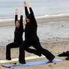ALLEGRA BOVERMAN/Staff photo. Gloucester Daily Times. Gloucester: From left: Cristin Carroll and Christine Kowal, both of Wakefield, do yoga at the waterfront in Rockport on Monday afternoon. They love visiting Rockport to shop, and love doing yoga, and they were able to do both on Monday, plus take a stroll, look for seaglass and have lunch.