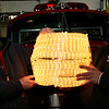 ALLEGRA BOVERMAN/Staff photo. Gloucester Daily Times. Rockport: Rockport firefighters Kevin Beaulieu (right) and Bill Montgomery, of the Rockport Fire Department, hold up the New Year's Eve ball that will be lowered from the ladder truck at Dock Square in the final countdown to 2012. They made the ball about seven years ago.