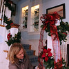ALLEGRA BOVERMAN/Staff photo. Gloucester Daily Times. Rockport: Sue Andersen adds decorations to the stairwell of the Captain's House Inn on Tuesday morning in preparation for the Seashells and Jingle Bells Inn and Home Kitchen Tour of Rockport which will be held on December 10th from 1- 6:00pm - Visit 4 beautiful seaside homes and 6 inns decked out for the holidays. There will be demonstrations and fun events at each location including seasonal food sampling, candy making, gingerbread house construction, music and a visit to Santas cottage The tour and registration will begin at Rockport Inn and Suites at 183 Main St. in Rockport. Tickets are $15 in advance and $20 on event date. Advance tickets may be purchasedÊat Ace Hardware Stores in Gloucester and Rockport, Brothers Brew in Rockport, Toad Hall Books in Rockport and Rockport Inn and Suites. For information, email RHS teacher Scott Larsen at slarsen@rockport.k12.ma.us.