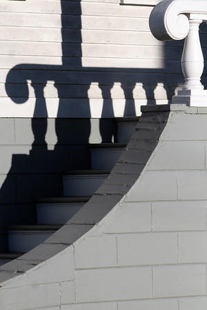 ALLEGRA BOVERMAN/Staff photo. Gloucester Daily Times. Rockport: Dramatic lighting accents a home's front stairway along High Street in Rockport in the late afternoon on Thursday.