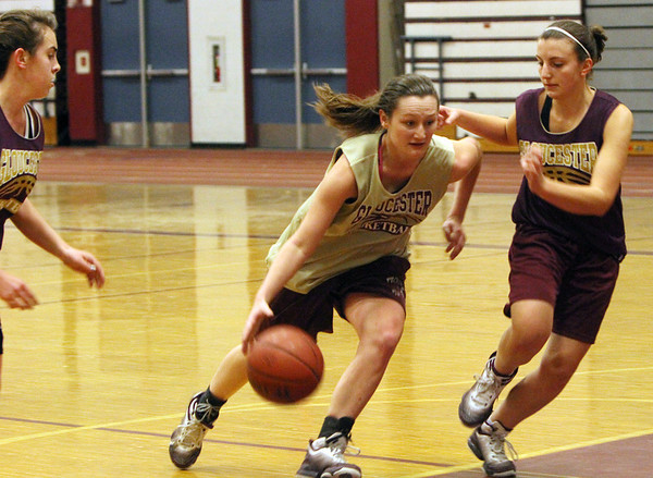 ALLEGRA BOVERMAN/Staff photo. Gloucester Daily Times. Gloucester: From left during their practice on Wednesday are Gloucester Varsity Girls Basketball teammates Amber Rallo, Audrey Knowlton and Sam Oliver.