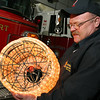 ALLEGRA BOVERMAN/Staff photo. Gloucester Daily Times. Rockport: Rockport firefighters Kevin Beaulieu (and Bill Montgomery, not shown) of the Rockport Fire Department, holds up the New Year's Eve ball that will be lowered from the ladder truck at Dock Square in the final countdown to 2012. They built the ball about seven years ago.