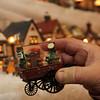 ALLEGRA BOVERMAN/Staff photo. Gloucester Daily Times. Gloucester: Details of the huge village holiday display at Vincent Orlando's home in Gloucester. This little cart shows the details of many of the pieces in his collection.
