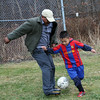 ALLEGRA BOVERMAN/Staff photo. Gloucester Daily Times. Gloucester: Wilson Emmanull DeLeon, Jr., 6, right, plays soccer with his grandfather, Hugo Ortiz, visiting from Austin Texas, on Tuesday afternoon at Mattos Field on Webster Street.