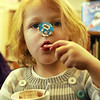 Essex-August Capotosto, 3, of Essex, enjoys her candy cane and hot cocoa at the T.O.H.P. Burnham Library, where a celebration of National Hot Cocoa Day was held on Tuesday afternoon. Jesse Poole/Gloucester Daily Times Dec. 13, 2011