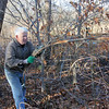 "Courtesy photo/Gloucester Daily Times.Rockport: Carl Gibbs of Rockport clears debris from the Nugent Stretch in Rockport on Tuesday afternoon. <br /> He had earlier cleared trash from the area, and was piling up dead tree limbs and branches neatly ""so it looks nicer in the spring."" He goes and clears roadsides like this as often as he can, and has done so no matter where he's lived, ""a little bit at a time."""