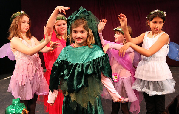 "ALLEGRA BOVERMAN/Staff photo. Gloucester Daily Times. Gloucester:<br /> During rehearsal of ""Holiday Delights,"" a holiday celebration of stories, songs and dance by the Gloucester Stage Youth Acting Workshops.  Rehearsing ""The Very Best Christmas Tree""  are, at center, Little Tre played by Ella de Gaspe Beaubien surrounded by the fairies of the forest, from left: Lainy Turner, TS Burnham, Sara Wheeler & Grace Dolan. Hidden from view is fairy Ruby Featherstone."