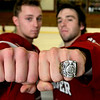 ALLEGRA BOVERMAN/Staff photo. Gloucester Daily Times. Gloucester: <br /> Kathy Milbury of Rockport brought her brother Michael MIlbury's Stanley Cup ring to the Gloucester high school varsity boys hockey team practice on Tuesday. Wearing the ring at right is co-captain Johnny Interrante, with co-captain Vincenzo Terranova.