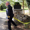 ALLEGRA BOVERMAN/Staff photo. Gloucester Daily Times. Essex: Essex Police Chief Pete Silva puts up caution tape at 72 Belcher Street in Essex while a fire was being put out there and an investigation was underway on Friday afternoon.