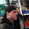 ALLEGRA BOVERMAN/Staff photo. Gloucester Daily Times. Gloucester: Charlie Williams, 25, of Gloucester, aboard the trawler Lady Jane, at the Gloucester Marine Railways. He will soon be out catching shrimp.