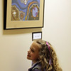 ALLEGRA BOVERMAN/Staff photo. Gloucester Daily Times. Rockport: During the opening of Gallery 24 @   Jerdens Lane at Rockport High School, Jessica Jones, 6, stands near the artwork of her mother, Pam Jones, a Rockport Middle School art teacher.