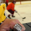 ALLEGRA BOVERMAN/Staff photo. Gloucester Daily Times. Gloucester: Kathy Milbury of Rockport shows her brother Michael Milbury's Stanley Cup ring at practice with the Gloucester boys varsity hockey team. Her brother was a longtime Bruins player, coach and now a NESN commentator.