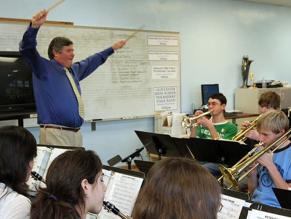 ALLEGRA BOVERMAN/Staff photo. Gloucester Daily Times. Gloucester: William Goodwin, principal of Gloucester High School, takes over the Docksiders rehearsal on Tuesday afternoon while music director Dave Adams stepped out of the room for a few minutes.
