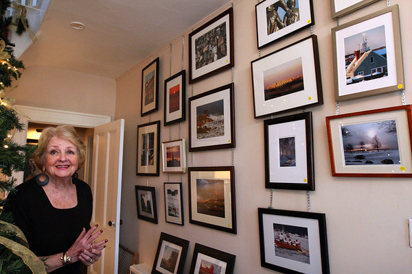 ALLEGRA BOVERMAN/Staff photo. Gloucester Daily Times. Rockport: Carol Carlson in the Carlson Gallery at her home in Rockport. Her late husband Sven Ohrvel Carlson and she were and are artists and musicians. A photography exhibit by Judith Oleson is on display at her house at the moment.