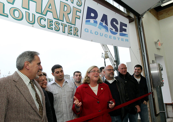 ALLEGRA BOVERMAN/Staff photo. Gloucester Daily Times. Gloucester: At the ribbon cutting for the new Base Gloucester fish auction mart at Fisherman's Wharf on Wednesday. From left are: Barry Pett of Sen. Bruce Tarr's office, Vito, Jenny, Nick and Chris Giacalone, Gloucester Mayor Carolyn Kirk, Richie and Ray Canastra of New Bedford, Vito Giacalone, Jr. and behind the Canastra family, Marc Giacalone.