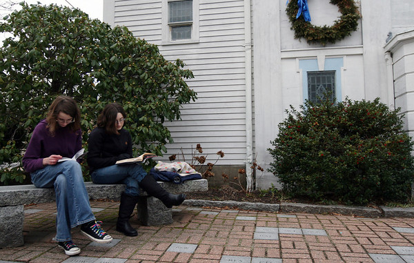 ALLEGRA BOVERMAN/Staff photo. Gloucester Daily Times. Rockport: From left, Lydia Vincent, 14, and Soni Razdan, 15, both of Rockport, read books while waiting for a friend participating in an activity at St. Mary's Episcopal Church in downtown Rockport on Tuesday afternoon. They were waiting to give her a plate full of cupcakes.<br /> , ALLEGRA BOVERMAN/Staff photo. Gloucester Daily Times. Rockport: From left, Lydia Vincent, 14, and Soni Razdan, 15, both of Rockport, read books while waiting for a friend participating in an activity at St. Mary's Episcopal Church in downtown Rockport on Tuesday afternoon. They were waiting to give her a plate full of cupcakes.