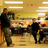 Jim Noble, Action's shelter manager, left, and Molly Derr, shelter councilor, wait in the lobby on Monday afternoon, ready for folks to come in around 5 p.m. Jesse Poole/Gloucester Daily Times Dec. 05, 2011